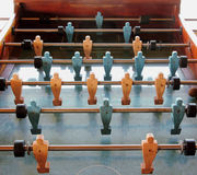 Old table football game. Old wooden table football game with plastic players Stock Photography