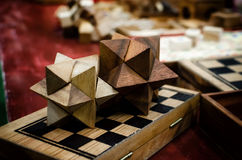 Old table game and puzzles. Old wooden table games, puzzles and chess board Royalty Free Stock Photo