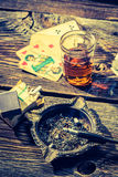 Old table for illegal poker with vodka, cigarettes and cards Royalty Free Stock Photography