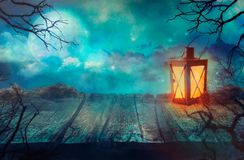 Old Table With Lantern And Full Moon. royalty free stock photos
