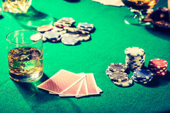 Old table for poker with whiskey, cigar and cards Stock Images