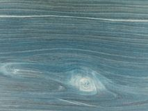 The old table top, worn out stained  navy blue with shades. Fine structure of cherry wood s. Aturated with blue mordant Stock Photography