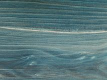 The old table top, worn out stained  navy blue with shades. Fine structure of cherry wood s. Aturated with blue mordant Stock Image