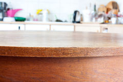 Old table with vintage kitchen defocused background. Royalty Free Stock Images