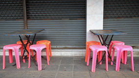Old tables and plastic chairs Royalty Free Stock Photos