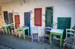 Old tables and seats on street. royalty free stock image