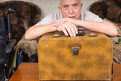 Old Tailor Guy Leaning on his Sewing Machine Case Royalty Free Stock Image