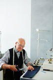Old Tailor Working in Atelier Royalty Free Stock Photos