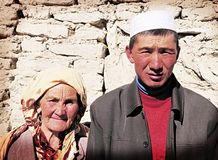 Old Tajik woman and son Stock Photos
