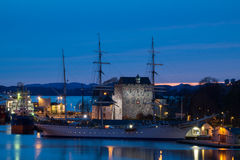 Old tall ship in front of Bergenhus Festning, Bergen, Norway Stock Photos