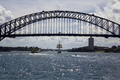 Old Tall Ship sailing through iconic Sydney harbour bridge Stock Photography