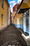 Old Tallin street. Narrow cosy street in center of old european town. Blue cloudy sky in background. Tallin, Estonia, Europe Stock Images