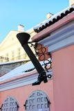 Old Tallin street view boot shaped drainpipe stock images