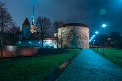 Old Tallinn at night. Legacy architecture of old Tallinn at night. Perspective view to Big Margareth tower Stock Photos