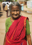 Old Tamil woman with red sari. Royalty Free Stock Photo