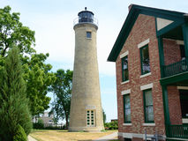 Old Tan Brick Lighthouse and Lightkeeper's House royalty free stock photos