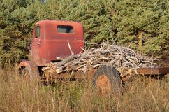 Old tandem junker truck loaded with branches Royalty Free Stock Photos