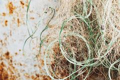 Old tangled fishing net on rusty blue metal background. Toned photo with illumination stock photos