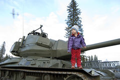 Old tank and girl Royalty Free Stock Images