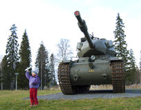 Old tank and girl in Boden Royalty Free Stock Photography