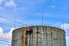 Old oil storage tank Stock Images
