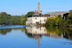 Old tannery along the Vienne River in Limousin. Old tannery reflected on water surface, Vienne River, Saint-Junien, Limousin, France Royalty Free Stock Images