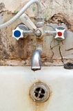 Old tap. Old rusty bath tap. unhealthy water concept Stock Photo