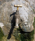 Old tap on the outside wall Stock Photo