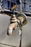 Old Tap with rosary beads in blessed fountain. In Azenhas do Mar culture prayer symbol meditation christianity suffering despair purity faith religion object stock photos