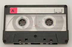 Old tape. Old audio tape with blank label and partialy rewinded royalty free stock photo