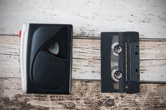 Old tape player, recorder and casette on wooden background Stock Images