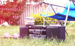 Old tape recorder in the garden Stock Photo