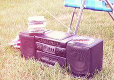 Old tape recorder on grass in the garden Royalty Free Stock Image