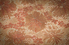 Old Tapestry fabric tinted sepia with vignetting effect as backg Stock Photography