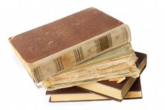 Old tattered books on white background Stock Photos
