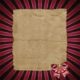 Old, tattered paper. On red, radiant background Royalty Free Stock Photo
