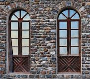 Old, tattered twin windows Stock Photography