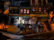 Old tavern at night in small Greek city stock image