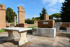 Old tavern in Ostia Antica. Ostia Antica is a large archeological site, close to the modern suburb of Ostia, that was the location of the harbour city of ancient Stock Photos
