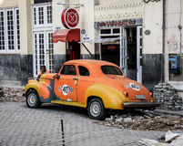 Old Taxi in broken street, Havana, Cuba Stock Image