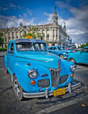 Old taxi outside the capitol building in havana Royalty Free Stock Image