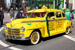 Old taxi at San Francisco Saint Patrick's Parade Stock Image