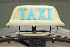 Old taxi sign on roof top car Stock Image