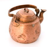 Old tea-pot from a copper. Ancient copper teapot a close up on a white background Stock Image