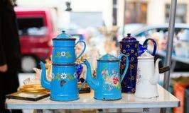 Old tea-pots on the flea market Stock Photo