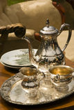 Old tea set. An old and vintage silver coated tea set royalty free stock photography