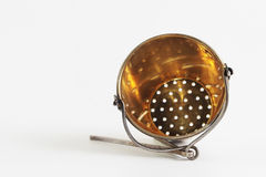 Old tea sieve. Tea silver sieve at white background Stock Photography