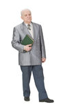 Old teacher. Senior man standing up an holding a book Royalty Free Stock Photos