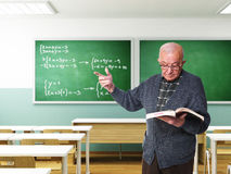 Old teacher in action Stock Photography