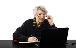Old teacher listening to the student online Royalty Free Stock Photos